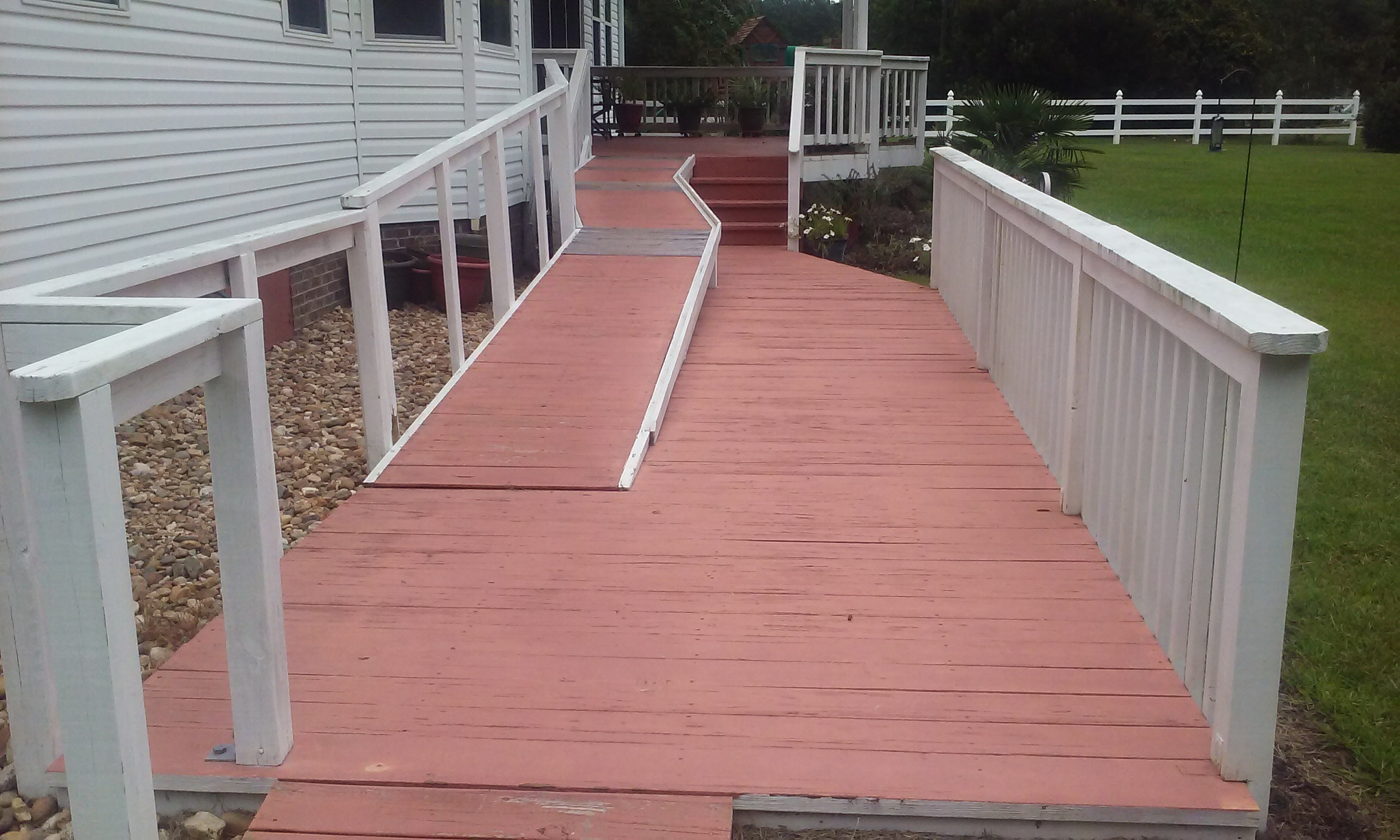 Upgrading a Walk way and Ramp with posite Decking and Railing